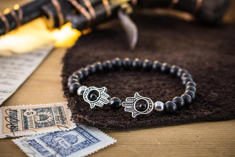 Matte black onyx beaded stretchy bracelet with silver Hamsa hands