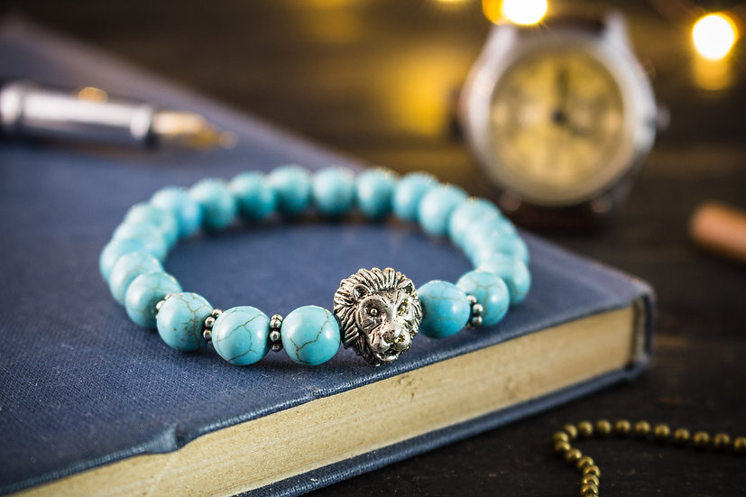 Turquoise beaded stretchy bracelet with a silver lion