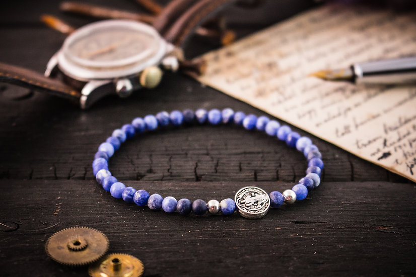 Matte blue sodalite beaded stretchy bracelet with sterling silver accents