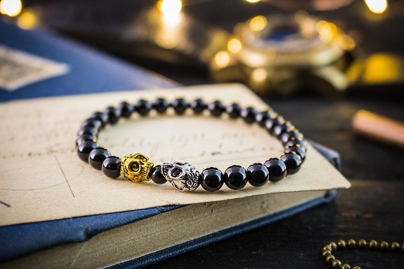 Black onyx beaded stretchy bracelet with gold & silver skulls