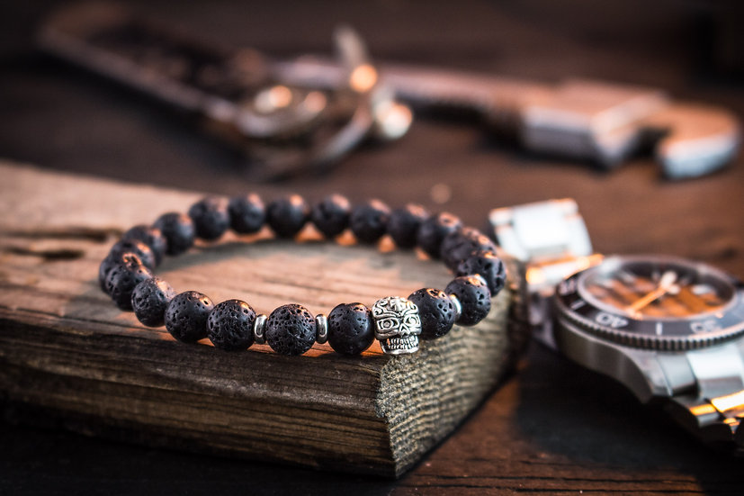 Black lava stone beaded stretchy bracelet with silver skull