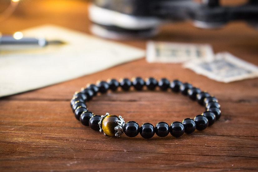 Onyx beaded stretchy bracelet with tiger eye bead