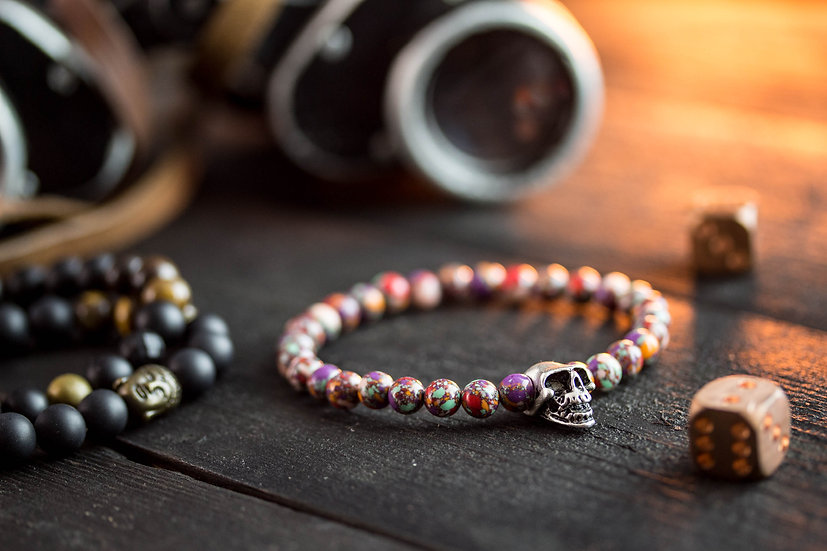 Pinkish colorful beaded bracelet with silver skull bead