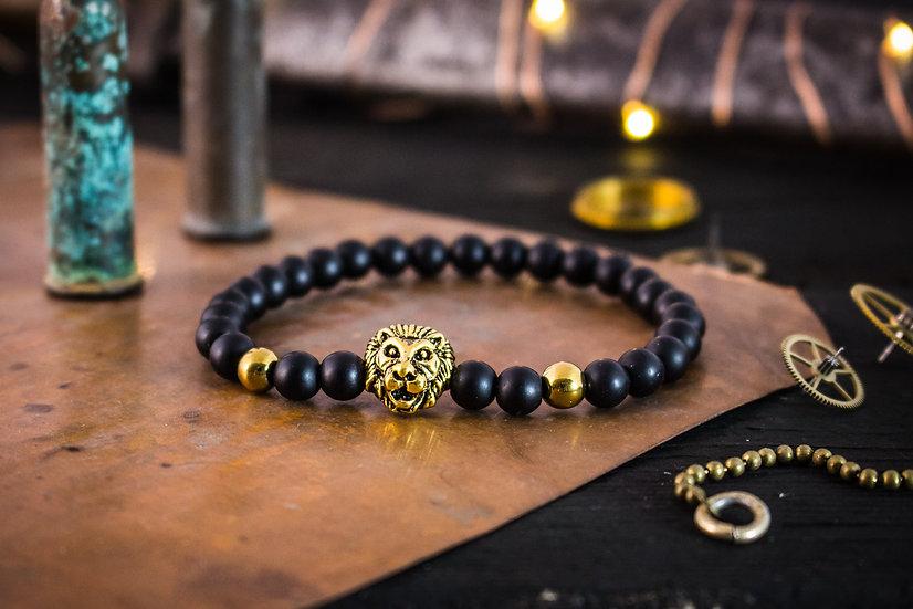 Matte black onyx beaded stretchy bracelet with gold Lion