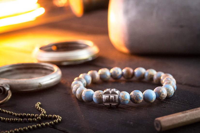 Light blue regalite beaded stretchy bracelet with stainless steel end bead