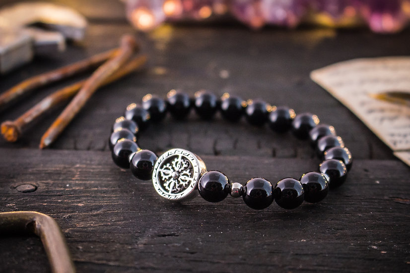 Black onyx beaded stretchy bracelet with a silver cross