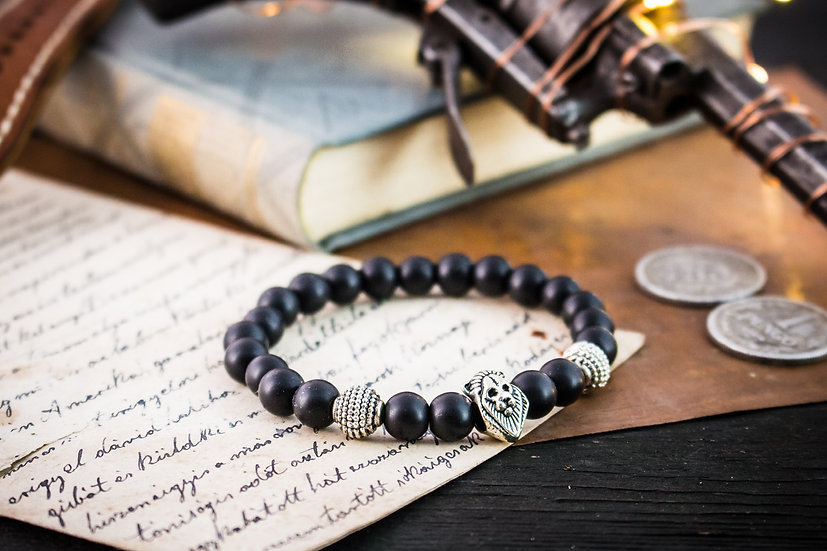 Matte black onyx beaded stretchy bracelet with silver lion & accents