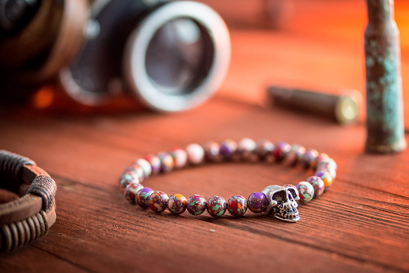 Pinkish colorful beaded men's bracelet with silver skull bead