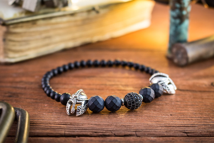Matte black faceted onyx beaded stretchy bracelet with silver spartan helmets