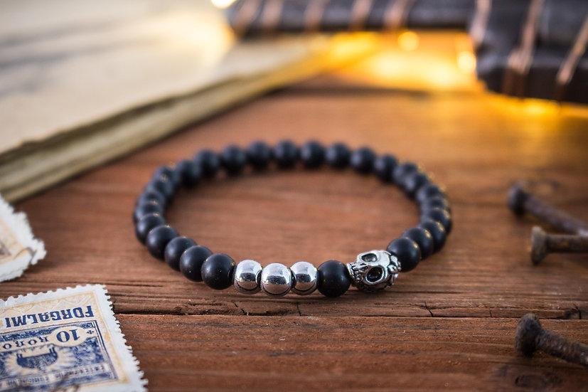 Matte black onyx beaded stretchy bracelet with silver skull