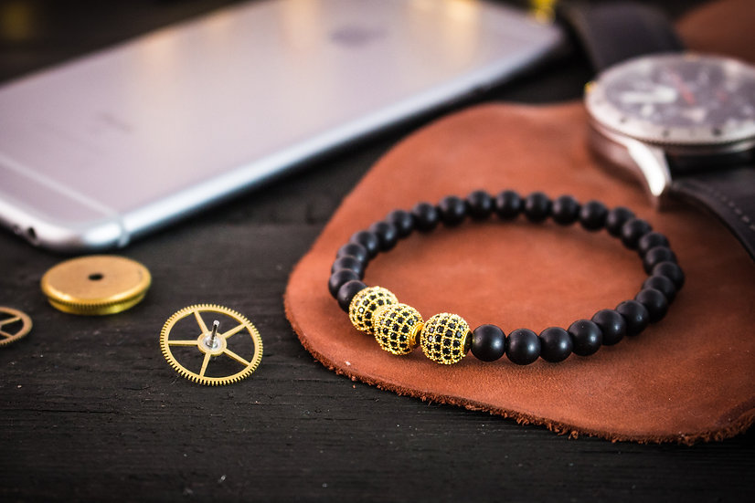 Matte black onyx beaded stretchy bracelet with gold micro pave beads