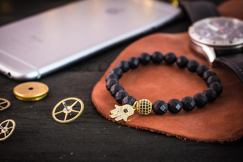 Matte black onyx beaded stretchy bracelet with gold micro pave Hamsa bead