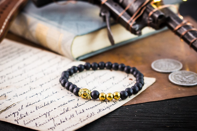 Matte black onyx beaded stretchy bracelet with gold skull & accents
