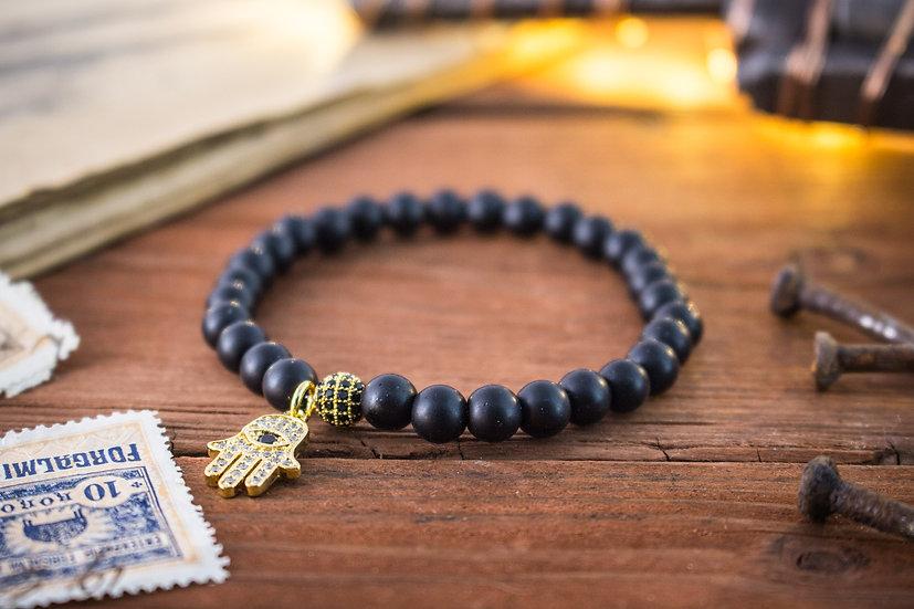 Matte black onyx beaded stretchy bracelet with gold Hamsa hand
