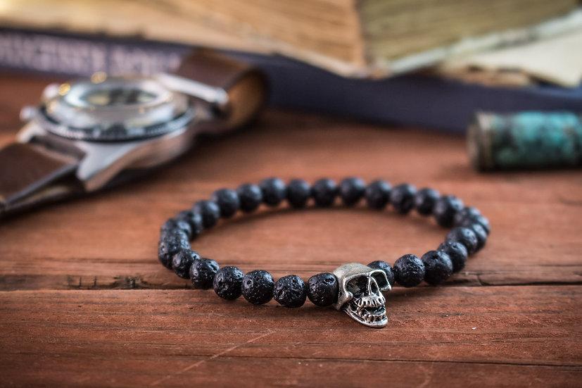 Black lava stone beaded stretchy bracelet with silver skull