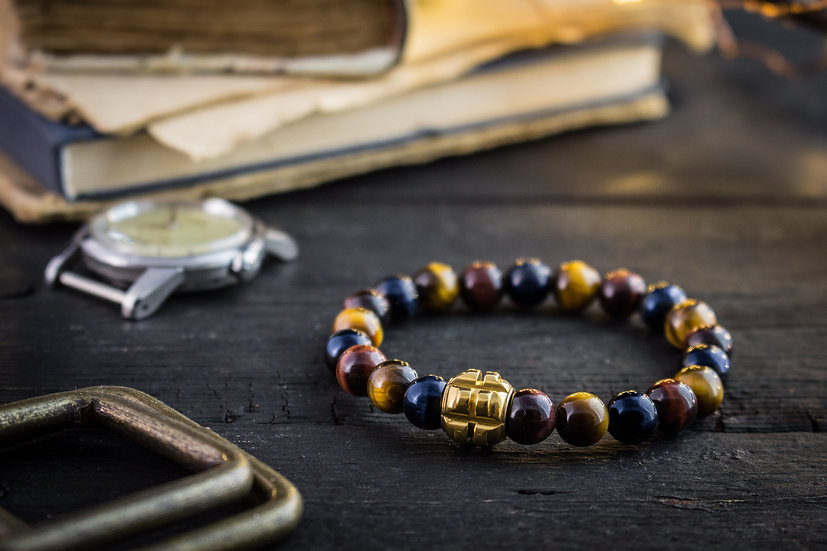 Blue, Red and brown tiger eye beaded stretchy bracelet with gold grenade bead