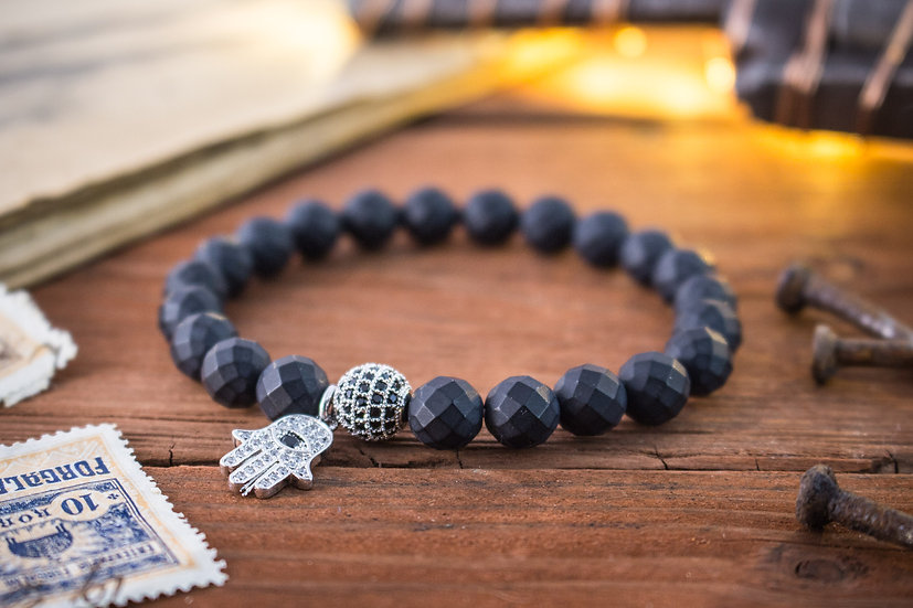 Matte black faceted onyx beaded stretchy bracelet with silver Hamsa charm