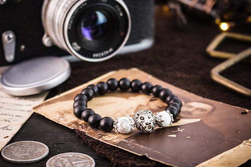 Matte black onyx & howlite beaded stretchy bracelet with silver lion