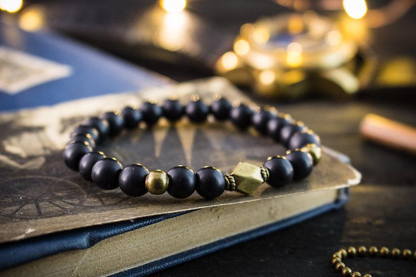 Matte black onyx beaded stretchy bracelet with bronze beads