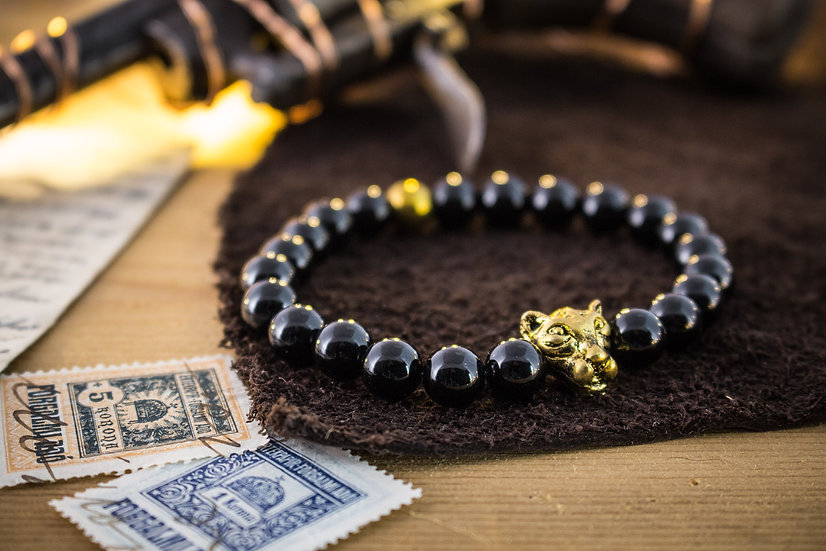 Black onyx beaded stretchy bracelet with gold Leopard
