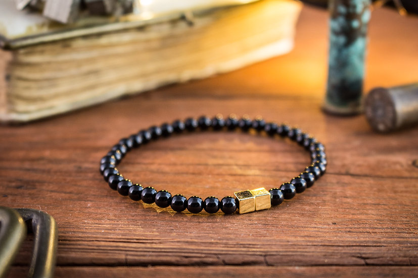 Black onyx beaded stretchy bracelet with gold cubes