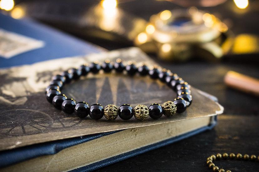 Black onyx beaded stretchy bracelet with bronze beads