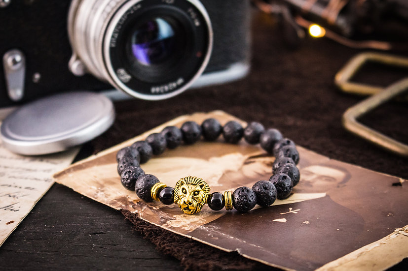 Black lava stone beaded stretchy bracelet with gold lion