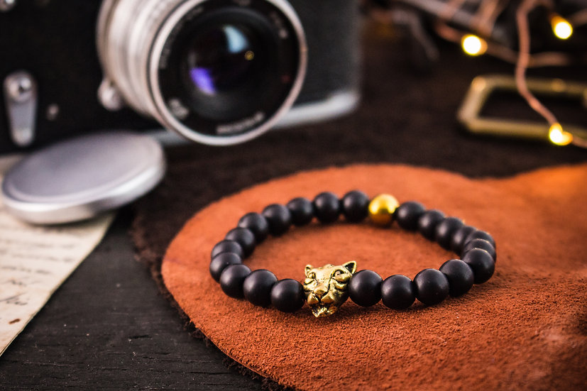 Matte black onyx beaded stretchy bracelet with gold leopard
