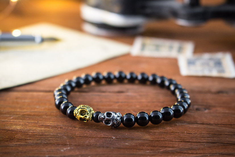 Onyx beaded stretchy bracelet with gold & silver skulls