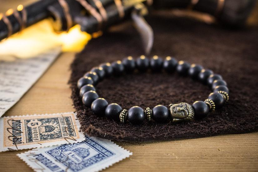 Matte black onyx beaded stretchy bracelet with bronze Buddha