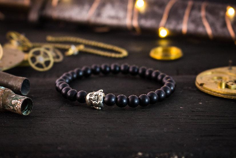 Matte black onyx beaded stretchy bracelet with silver Buddha