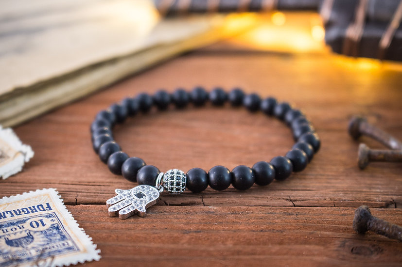Matte black onyx beaded stretchy bracelet with silver Hamsa charm