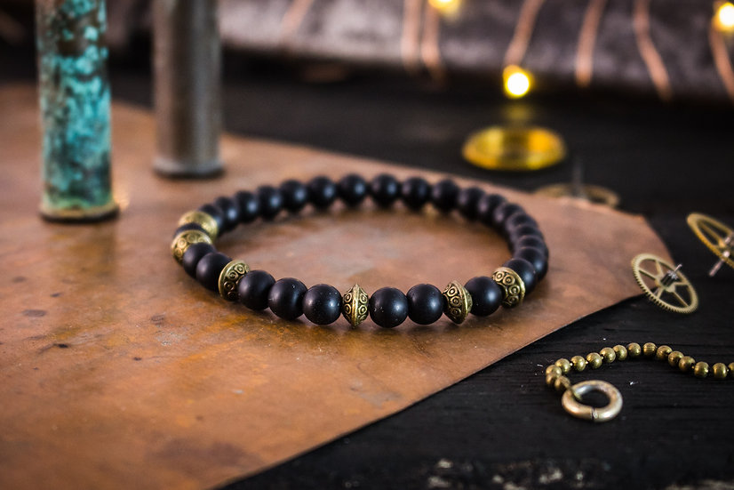 Matte black onyx beaded stretchy bracelet with bronze accents