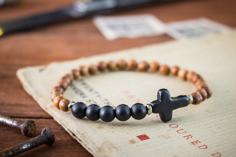 Matte black onyx & sandalwood beaded bracelet with black cross