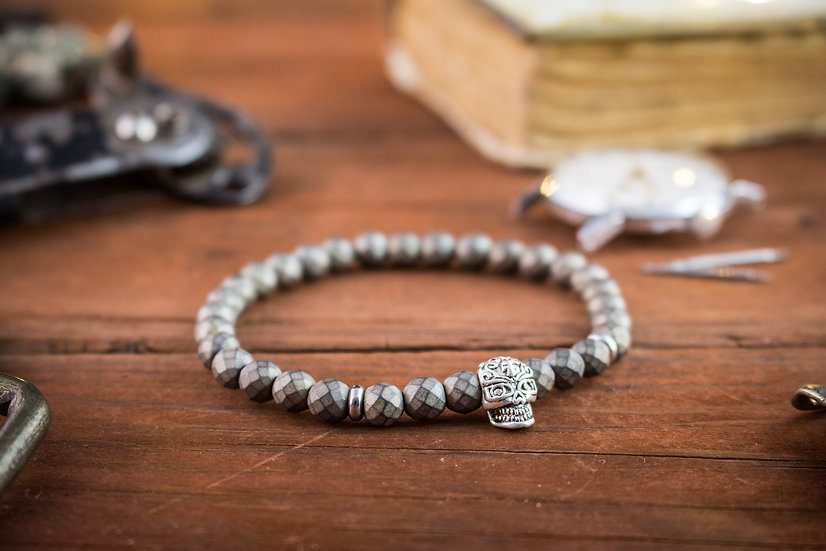 Faceted hematite beaded stretchy bracelet with silver skull