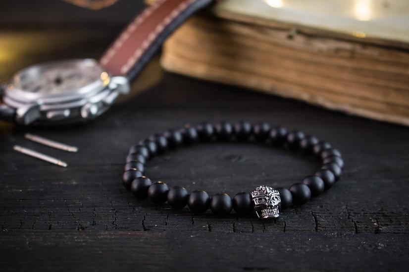 Matte black onyx beaded stretchy bracelet with gunmetal skull