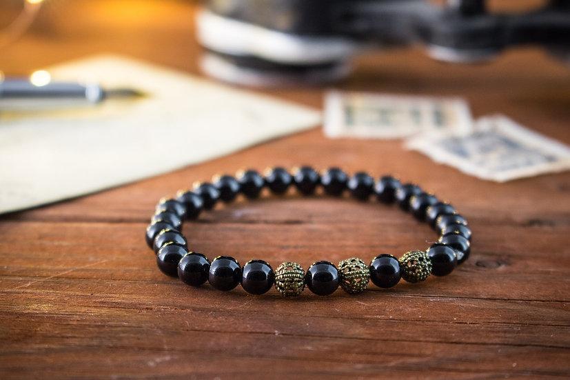 Onyx beaded stretchy bracelet with bronze beads