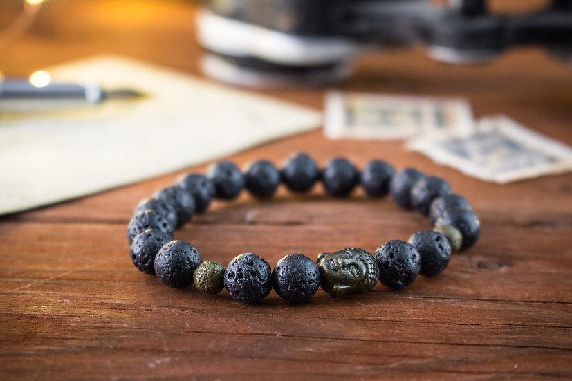 Black lava stone beaded stretchy bracelet with bronze Buddha