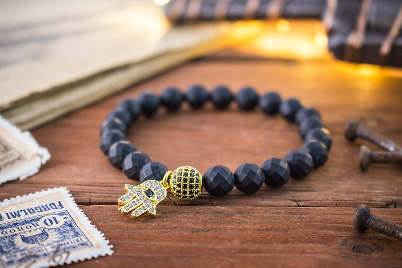 Faceted matte black onyx beaded stretchy bracelet with gold Hamsa hand