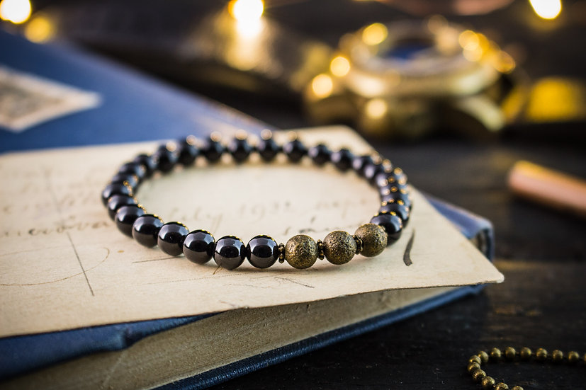 Black onyx beaded stretchy bracelet with bronze beads