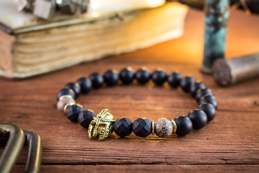 Matte black onyx beaded stretchy bracelet with gold spartan helmet