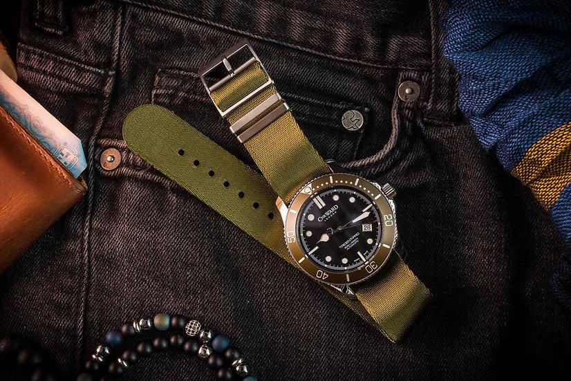 Olive Green Tudor style Single Pass Seatbelt NATO Watch Strap on a Christopher Ward C60 Trident-Pro Olive Bezel