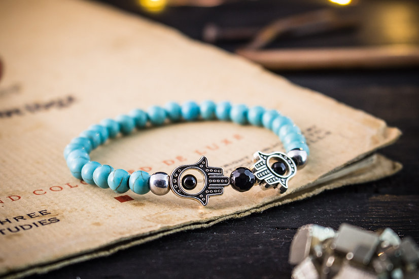Turquoise beaded stretchy bracelet with hands of Hamsa
