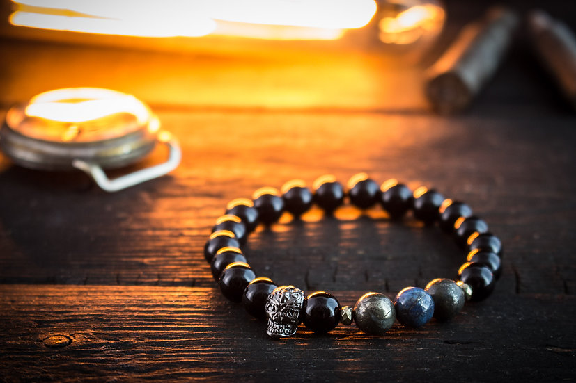 Black lava stone & half blue pyrite beaded stretchy bracelet with gunmetal skull