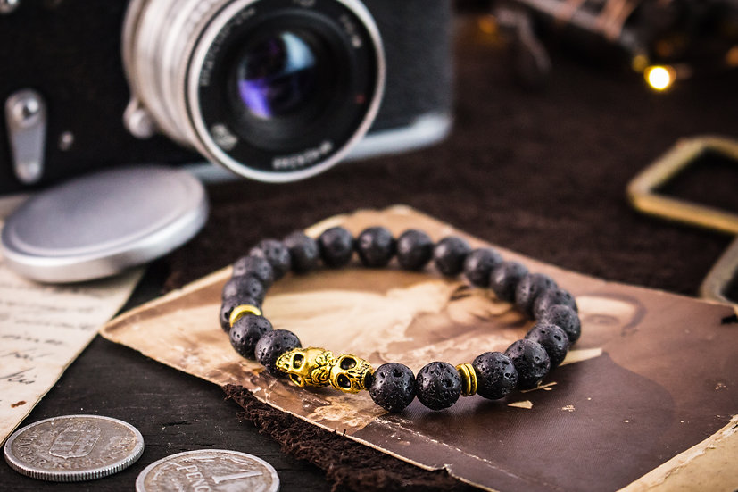 Black lava stone beaded stretchy bracelet with gold skulls & accents