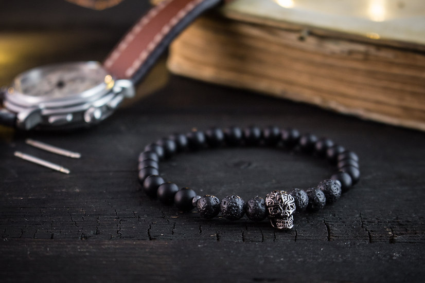 Matte black onyx & lava stone beaded stretchy bracelet with gunmetal skull