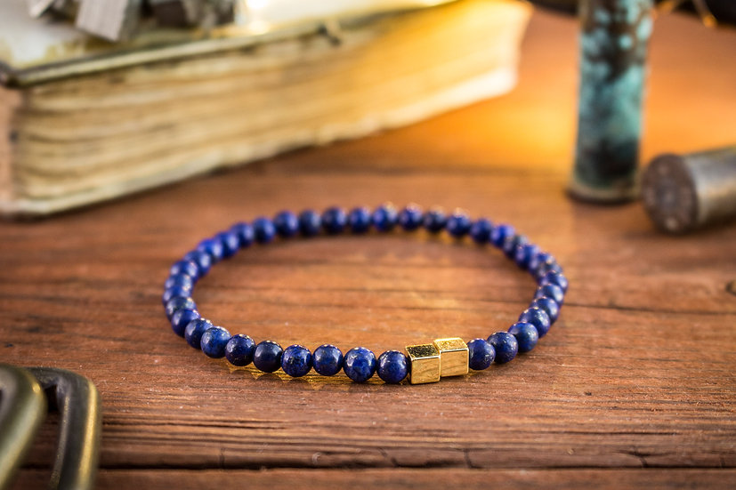 Blue lapis lazuli beaded stretchy bracelet with gold cubes