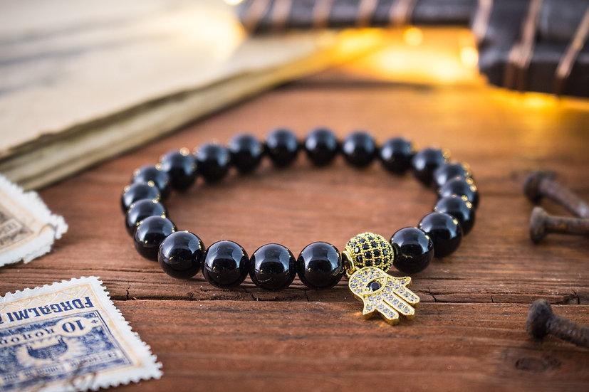 Black onyx beaded stretchy bracelet with gold Hamsa hand