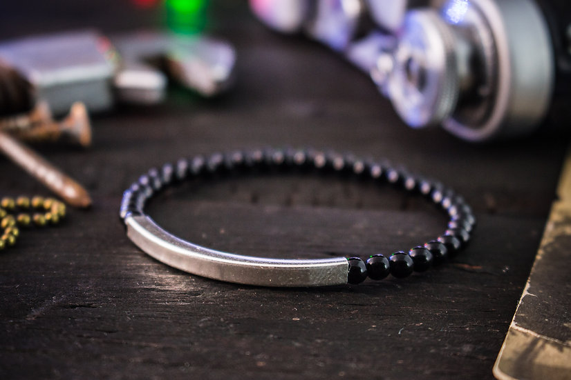 Black onyx beaded stretchy bracelet with sterling silver tube