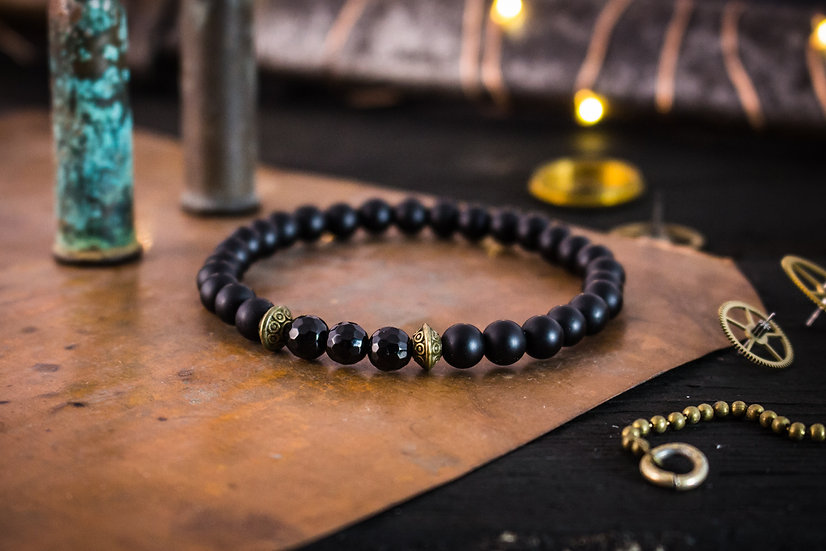 Matte black onyx beaded stretchy bracelet with bronze rings